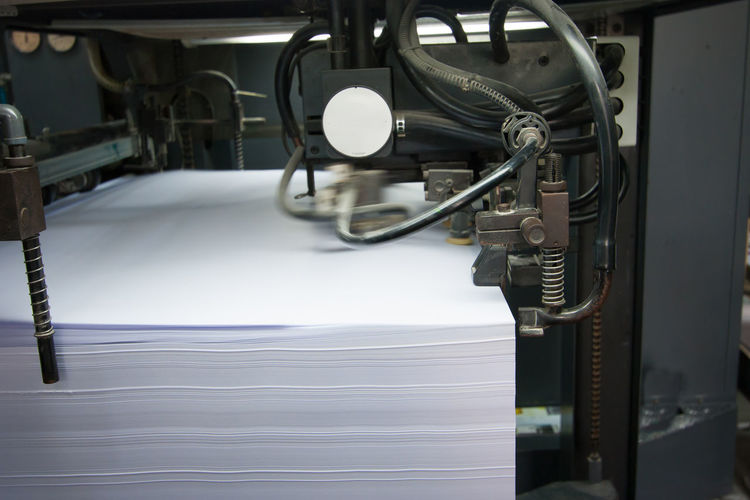 Stack of paper in machinery at factory