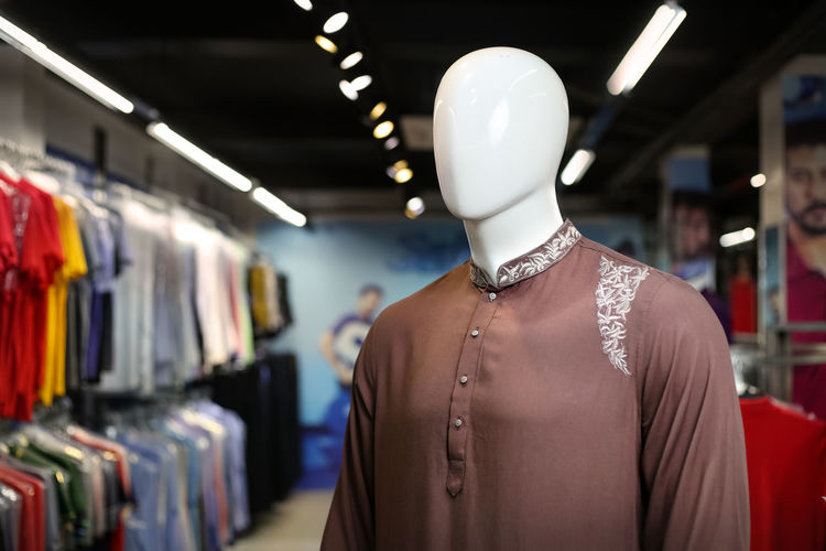 Close-up of brown kurta on mannequin in store