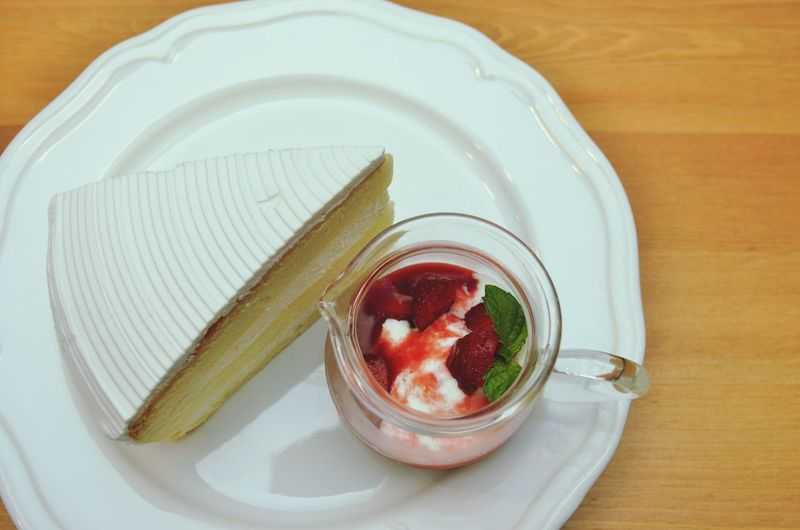 Slice Of Cake And Ice Cream On Plate