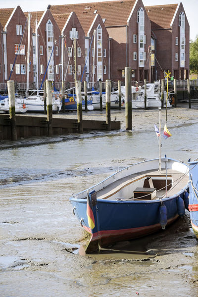 City Downtown Harbor Boat Building Coast Day Ebb Ebb And Flow Husum Low Tide Mudflats Nature Nautical Vessel North Sea Old Outdoors Pier Port Sea Tourism Town Transportation Wadden Sea Water