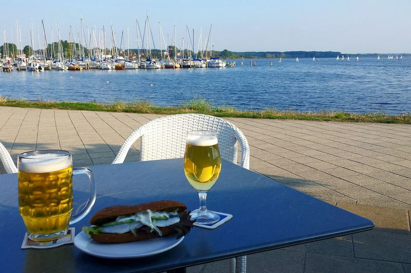 Breadroll With Bismarckhering Beers Food And Drink Relaxing Time Nautical Vessel Sea Vibrant Color Freshness Harbor Vacations Outdoors Sky Day Tranquility Tourism Ladyphotographerofthemonth Holiday POV Boats At Sunset  Boats Sea And Sky Non-urban Scene Harbor Tranquil Scene No People Marina Journey Place Of Heart Done That. Lost In The Landscape Food Stories