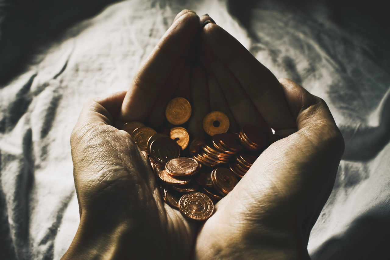 Holding coins in hands