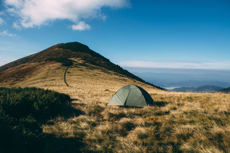 Tent on mountain against sky