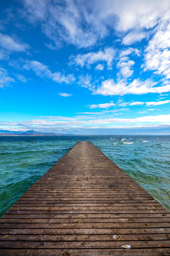 Vertical Panorama of Lake Garda, Italy with an old wooden pier jutting out into the water Blue Cloud - Sky Diminishing Perspective Garda Lake Horizon Over Water Idyllic Italy Lake Nature No People Old Outdoors Pier Scenics - Nature Sirmione Sky The Way Forward Tranquil Scene Tranquility Vertical Panorama Water Wide Angle View Wood - Material Wooden
