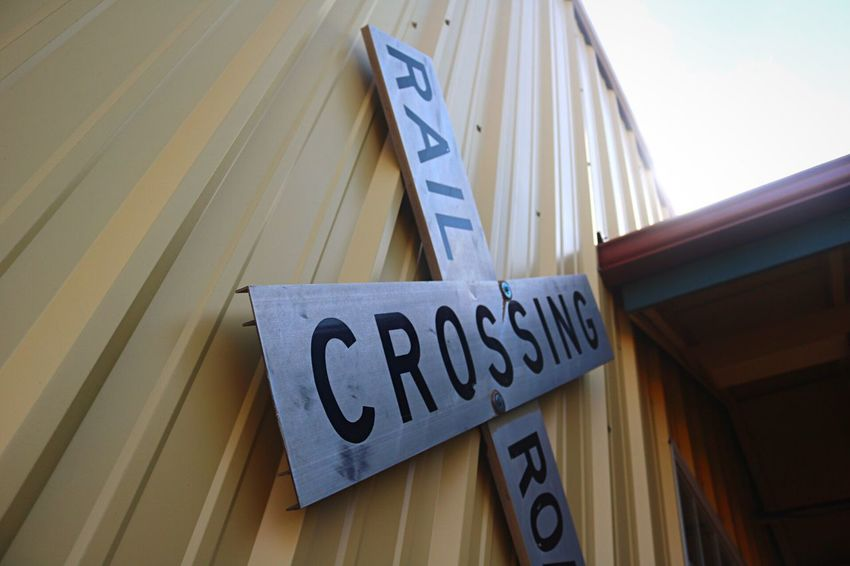 Sitting at the crossroads : Downtown Springdale, Arkansas. Railroad Crossing Trains Train Station Arkansas Signs Canon Canonphotography History Missouri