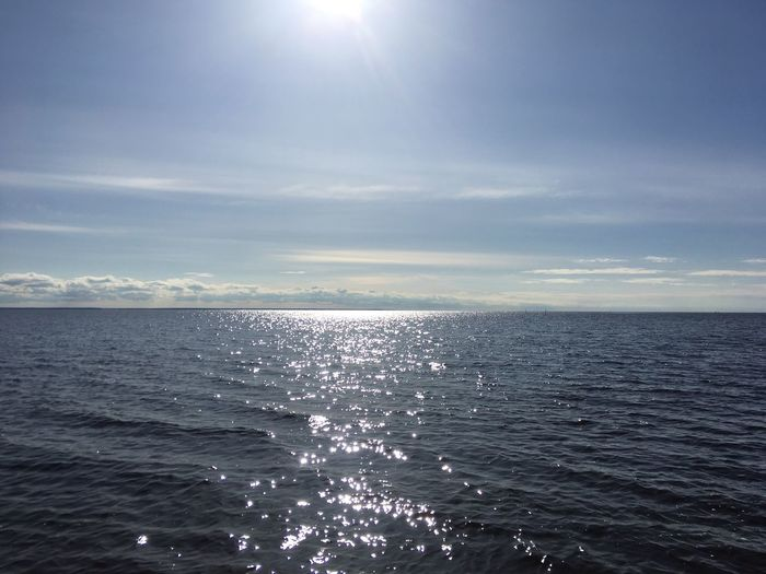 White Sea Tranquil Scene Tranquility Cloud - Sky Horizon Reflection Horizon Over Water Outdoors No People Day Waterfront Idyllic Lens Flare Sunbeam