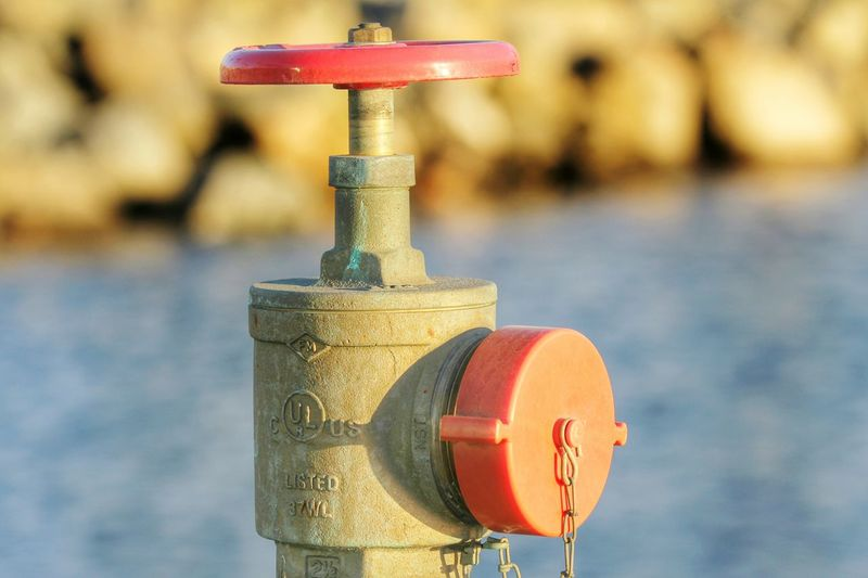 Waterfront Fire Plug Fire Plug Red Cap Fire Fighting Equipment Fire Suppression Photography Is My Escape From Reality! Close-up Outdoors Perspective ForTheLoveOfPhotography Eyeemphotography Eye4photograghy Photography Is My Therapy Eyeem Market From My Point Of View Nozzle Waterfront