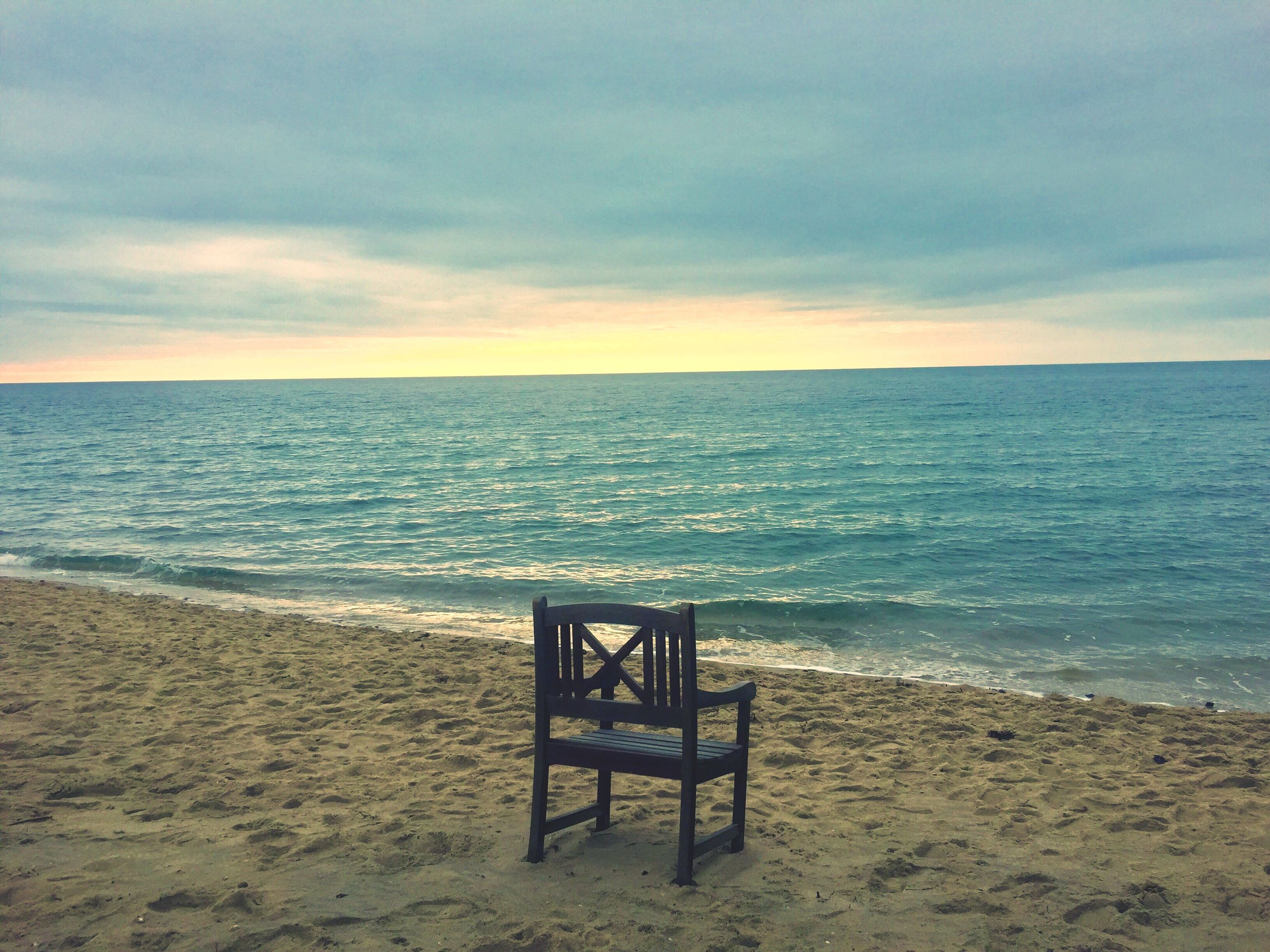sea, horizon over water, chair, beauty in nature, sky, nature, scenics, tranquility, idyllic, water, cloud - sky, outdoors, sunset, no people, beach, table, day
