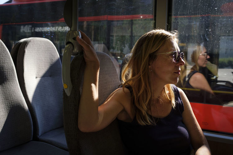 Midsection of woman sitting in bus