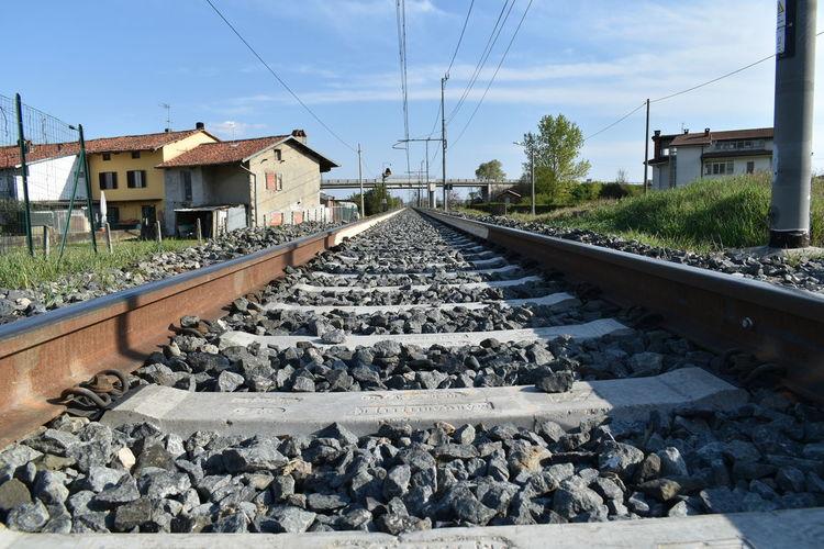 Railroad track amidst rocks against sky