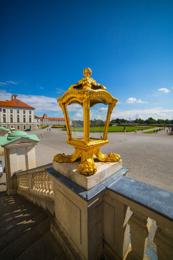 Gold lamp on steps railing at nymphenburg palace