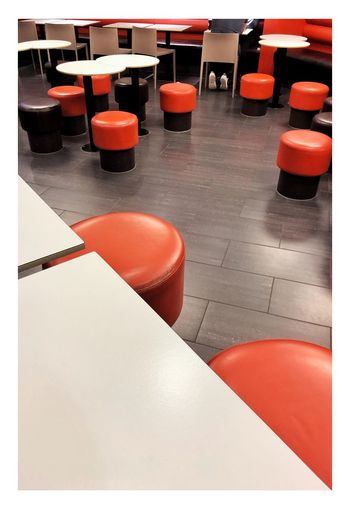 High angle view of chairs and tables in restaurant