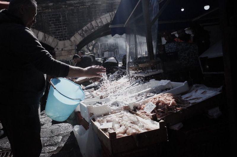 Man working at market stall