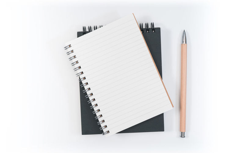 White Background Studio Shot Paper No People Indoors  Still Life Note Pad Pen Copy Space Spiral Notebook Blank Writing Instrument Book High Angle View Publication Close-up Education Directly Above White Color Two Objects Message