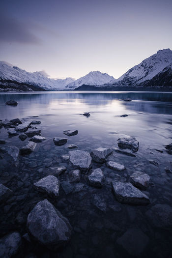 Beauty In Nature Cold Temperature Idyllic Lake Mountain Mountain Range Nature No People Non-urban Scene Reflection Rock Rock - Object Scenics - Nature Sky Solid Tranquil Scene Tranquility Water Winter