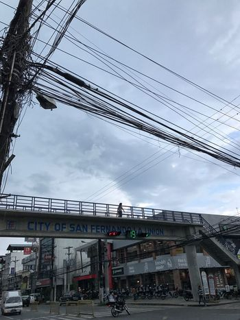 Busy lazy street Sky Built Structure Transportation Cloud - Sky Connection Architecture Power Line  Day Outdoors Building Exterior Low Angle View Electricity Pylon City No People