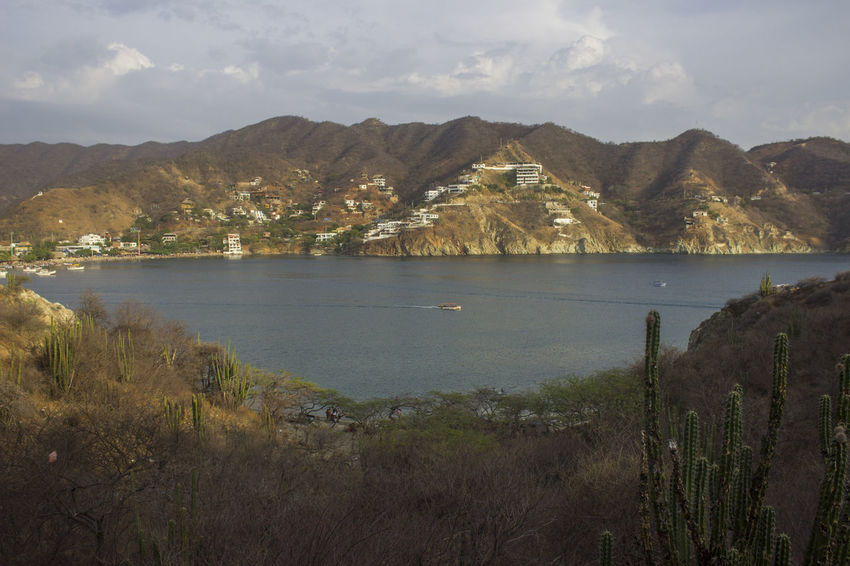 Beauty In Nature Day Grass Lake Landscape Mountain Mountain Range Nature No People Outdoors Scenery Scenics Sky Taganga Taganga Colombia Taganga Colombia. Tranquility Water