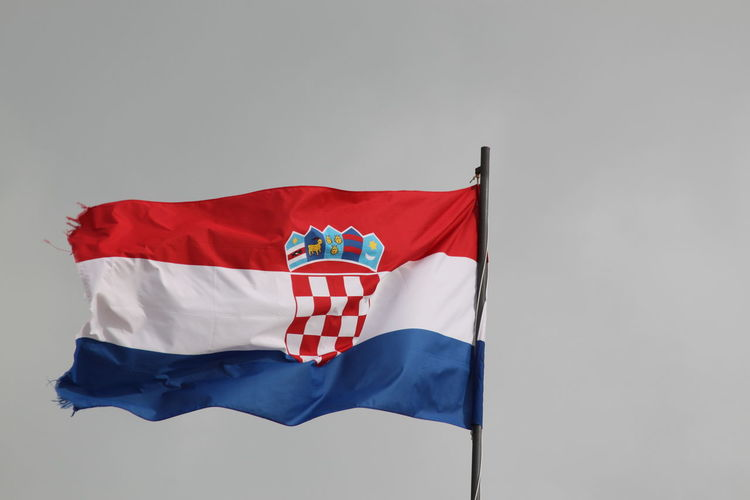 Low angle view of croatian flag against clear sky