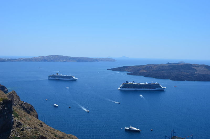 Cruise Ships And Yachts In Sea Against Clear Sky