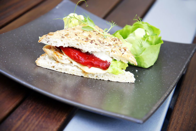 Close-Up Of Sandwich In Plate On Table