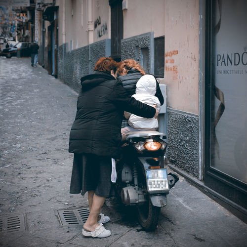 Succede a Napoli. Without A Helmet City Civic Sense Grandmother Irresponsibility Life Lifestyles Mother Naples On The Scooter Real People Scooter Son Street Three People