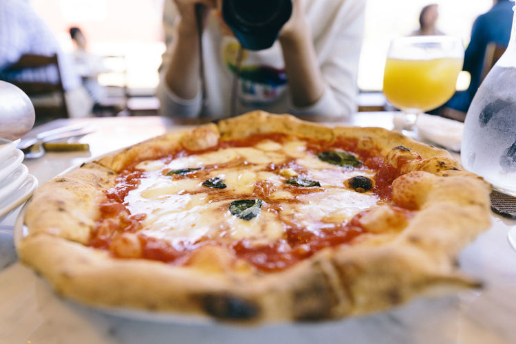 Close-up of pizza on table in restaurant