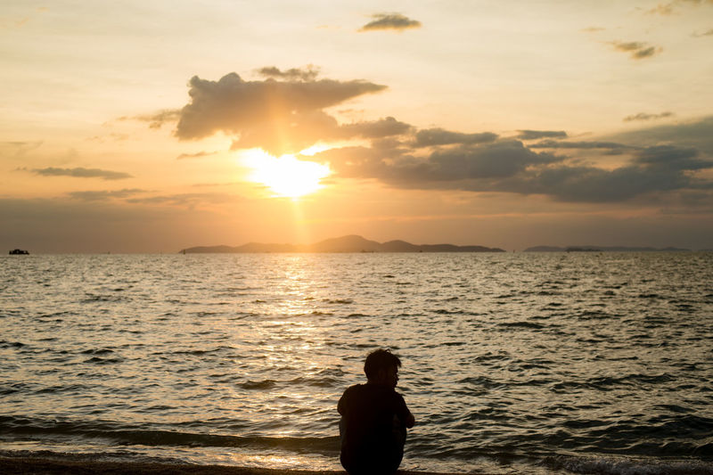 Sitting Waiting Wishing. Alone Alone Time Best EyeEm Shot EyeEm Nature Lover Silhouette Silouette & Sky Sitting Thinking Waiting Beauty In Nature Cloud - Sky Lifestyles Man And Sea Nature One Person Real People Sea Seascape Silouette Sitting Alone Sky Sun Sunset Water