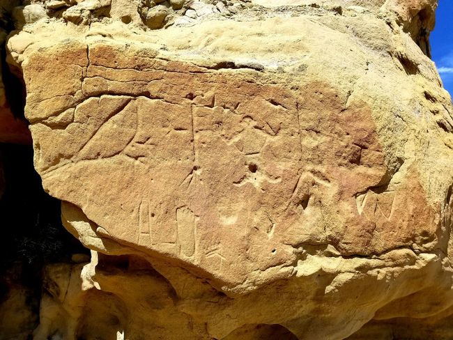 Petroglyphs Stories In Stone Wyoming White Mountain Historical Place Full Frame Close-up Rough Rugged Rock Arid Landscape