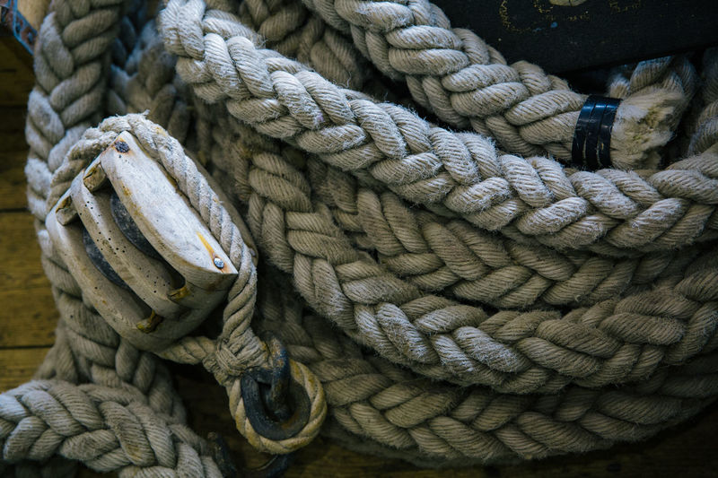 Close-up of coiled up rope in boat