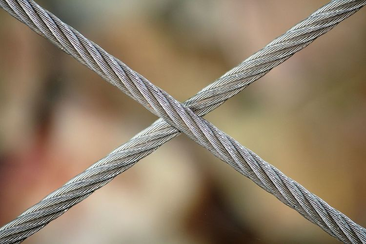 Cross purposes Backgrounds Cable Cables Chandler Chandlery Close Up Construction Crossed Wires Depth Of Field Detail Diagonal Diagonal Lines Diagonals Engineering Focus On Foreground Full Frame Marine No People Rigging Safety Selective Focus Steel Steel Cable Steel Cables Structure