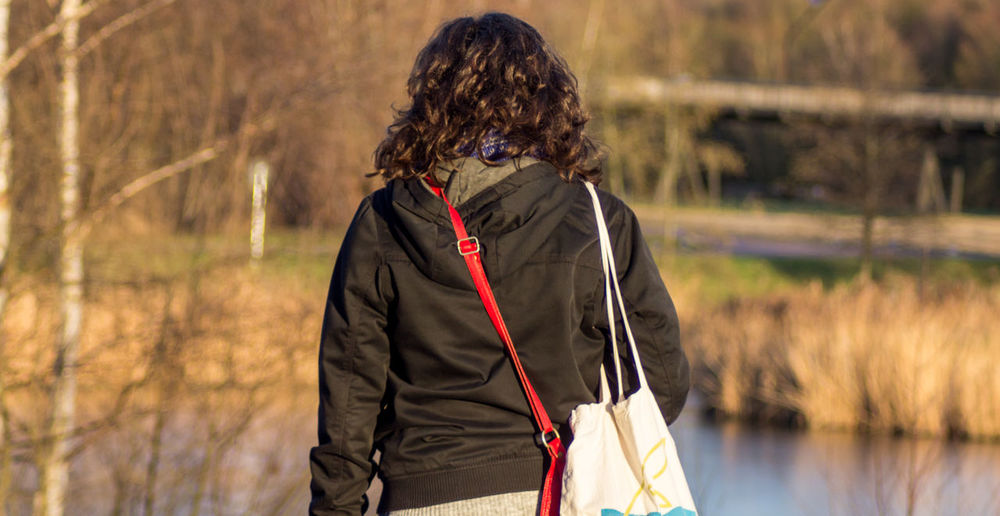 Walking in De schorre Adult Adults Only Backgrounds Curly Hair Day Human Hair Nature One Person One Woman Only One Young Woman Only Only Women Outdoors Parc People Rear View Walking Warm Clothing Young Adult