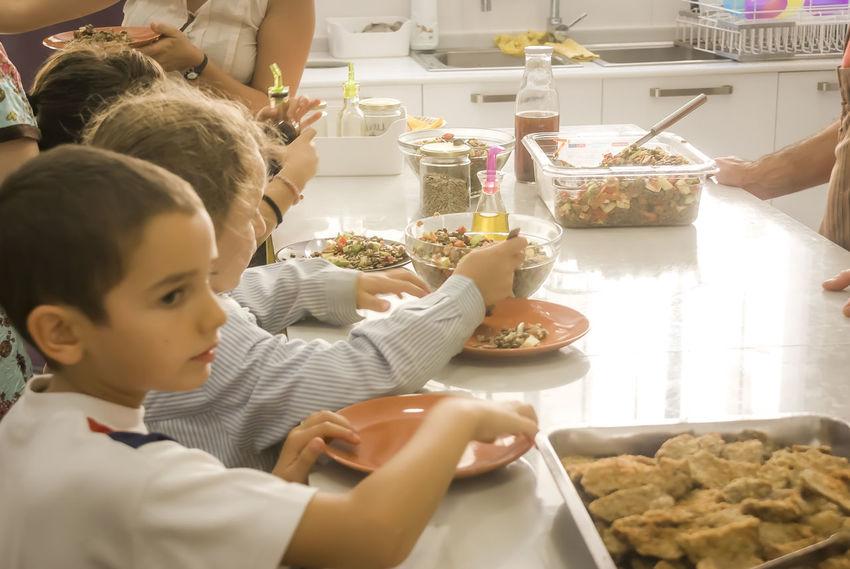 Kids serving thenself in a children dinner room Serving Food Child Child Autonomy Childhood Children Dinner Room Eating Food Growing Heathyfood Kids Luch Time Self Service Vegetables & Fruits Vegetarian Food