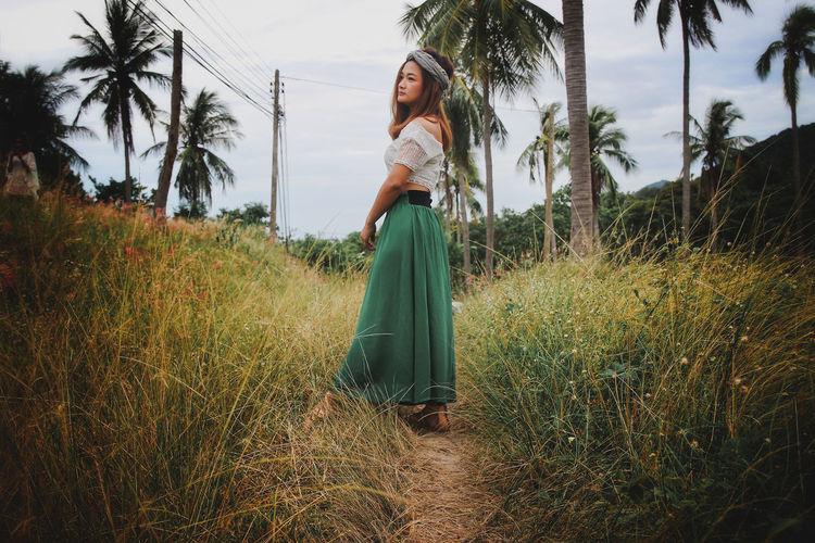 Woman walking on field