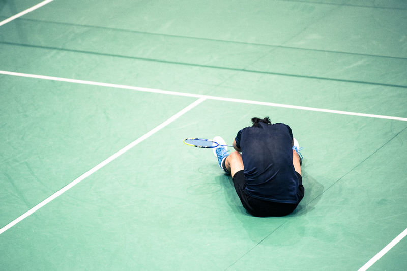 bad badminton Bad Day Bad Condition Bad Sport Badminton Camera - Photographic Equipment Casual Clothing Clothing Court Day Full Length Green Color High Angle View Leisure Activity Lifestyles Men One Person Outdoors Photography Themes Real People Rear View Sport Sports Clothing Tennis