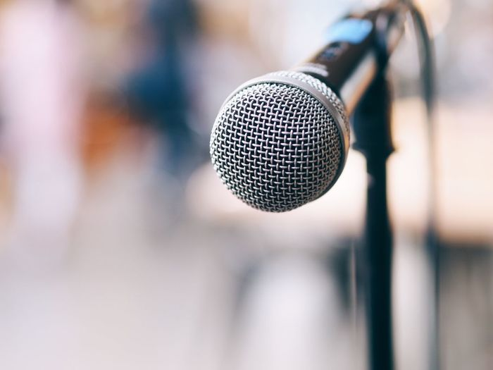 Close-up of microphone outdoors during sunny day