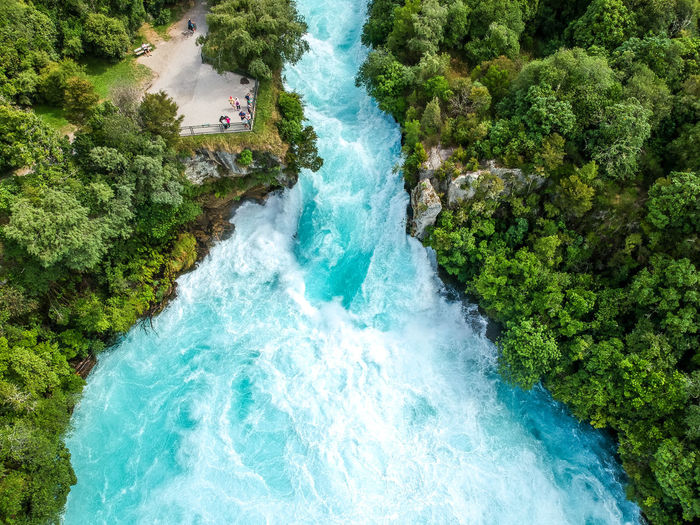 Stunning aerial wide angle drone view of Huka Falls waterfall in Wairakei near Lake Taupo in New Zealand. The waterfall is part of the Waikato River and is a major tourist attraction. Drone  Forces Of Nature Huka Falls, NZ Lake Taupo New Zealand Beauty Taupo Waikato River Aerial View Beauty In Nature Bestoftheday Dji Dji Spark Drone View High Angle View Huka Falls Ice Blue Nature New Zealand Outdoors Scenics Tourism Tree Water Waterfall Waterfalls