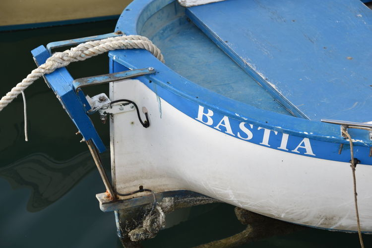 a small boat at the marina of bastia Nautical Vessel Mode Of Transportation Moored Transportation Blue Water Day No People Outdoors Nature High Angle View Boat Boats Fishing Boat Fishing Net