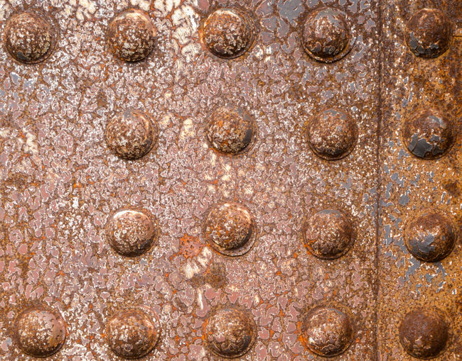 Rusty rivets of iron riveted steel construction background texture pattern Iron Iron - Metal Rusty Metal Background Texture Pattern Abstract Rusty Metal Panel Steel Construction Rivets Riveted Riveted Bolt No People Textured  Close-up Old Brown Weathered The Minimalist - 2019 EyeEm Awards