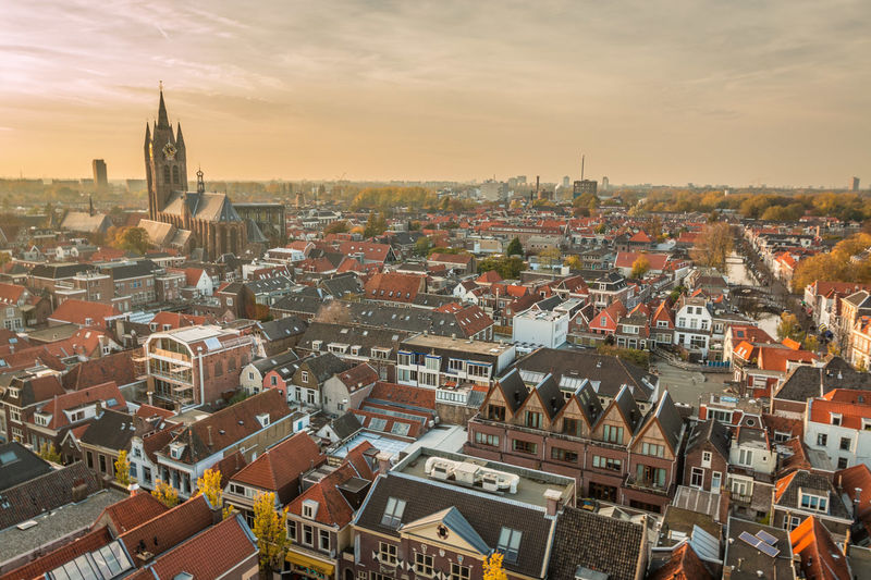 Very nice panoramic view of Delft in Holland Delft Delft, Netherlands Holland Architecture Building Exterior Built Structure City Building Cityscape Sky Roof Crowd Residential District High Angle View Crowded Cloud - Sky Nature Town Religion Place Of Worship Community Outdoors TOWNSCAPE Settlement