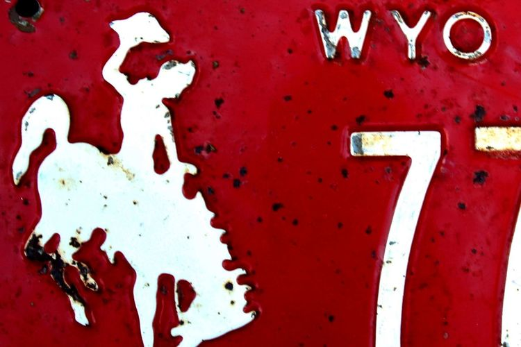 7 77 Bronco Bucking Bronco Color Red Cowboy Cowboyhat Dark Red  Deep Red Horse License Plate Number 7 Number 77 Red Red And White Sihouette  White On Red Wyo Wyoming Wyoming Adventure Wyoming USA