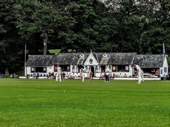 Plant Group Of People Tree Grass Green Color Playing Architecture Real People Men Large Group Of People Nature Crowd Built Structure Sport Day Building Exterior Growth Outdoors Child Cricket Field Cricket Match
