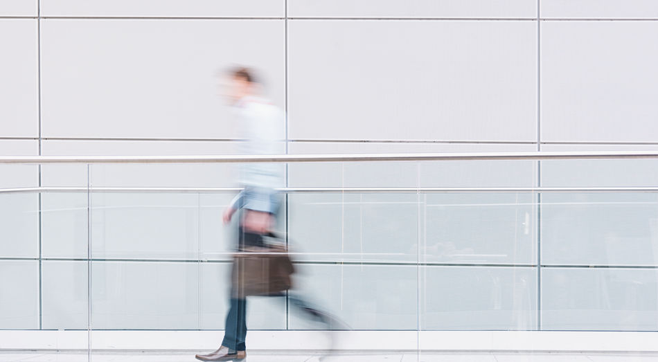 Blurred motion of person walking on tiled floor