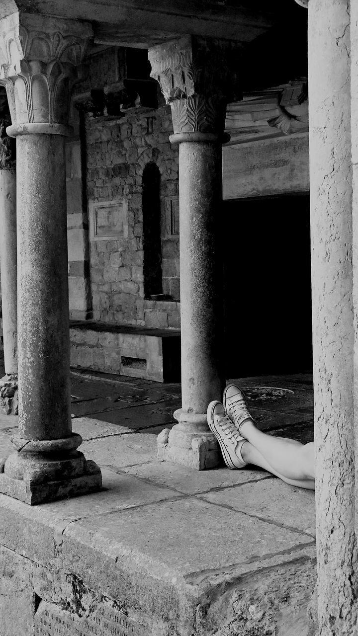 architectural column, architecture, built structure, one person, sitting, women, old ruin, real people, day, building exterior, ancient, full length, indoors, adult, people