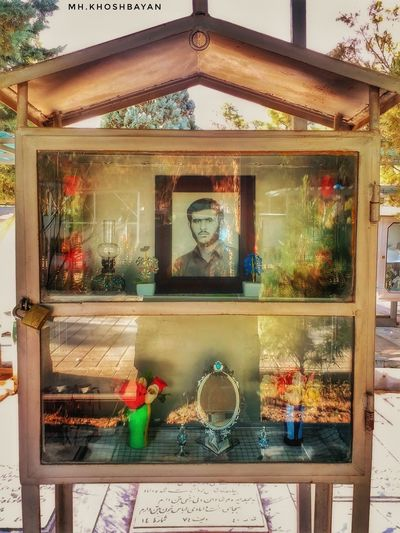 The Hijlah is a place box for memorial of the Martyrs which designed by their family, the Hijlah usually includes pictures، handwriting , holograms and Martyrs wills and also some memorial elements of their lifes. Martyrs Graveyard Cemetery Shahid Iran Memorial