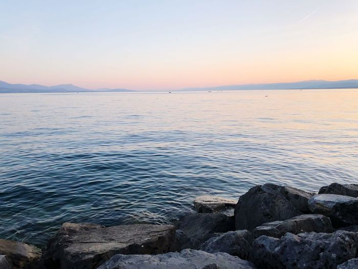 Lausanne Switzerland EyeEm Best Shots EyeEmNewHere Lac Léman Beauty In Nature Scenics - Nature Sky Sea Tranquility Water Tranquil Scene Sunset Beach Idyllic Horizon Over Water Land Nature Horizon Rock No People Non-urban Scene Rock - Object Clear Sky Outdoors