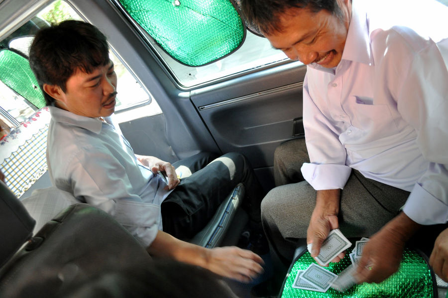 Men playing cards in van while travelling on Da Nang-Hue highway in Vietnam. Card Games Dealing Deck Of Cards Friendship Fun Gambling Leisure Lifestyles Men Playing Playing Cards Sitting Transport Travel Vans Vietnam