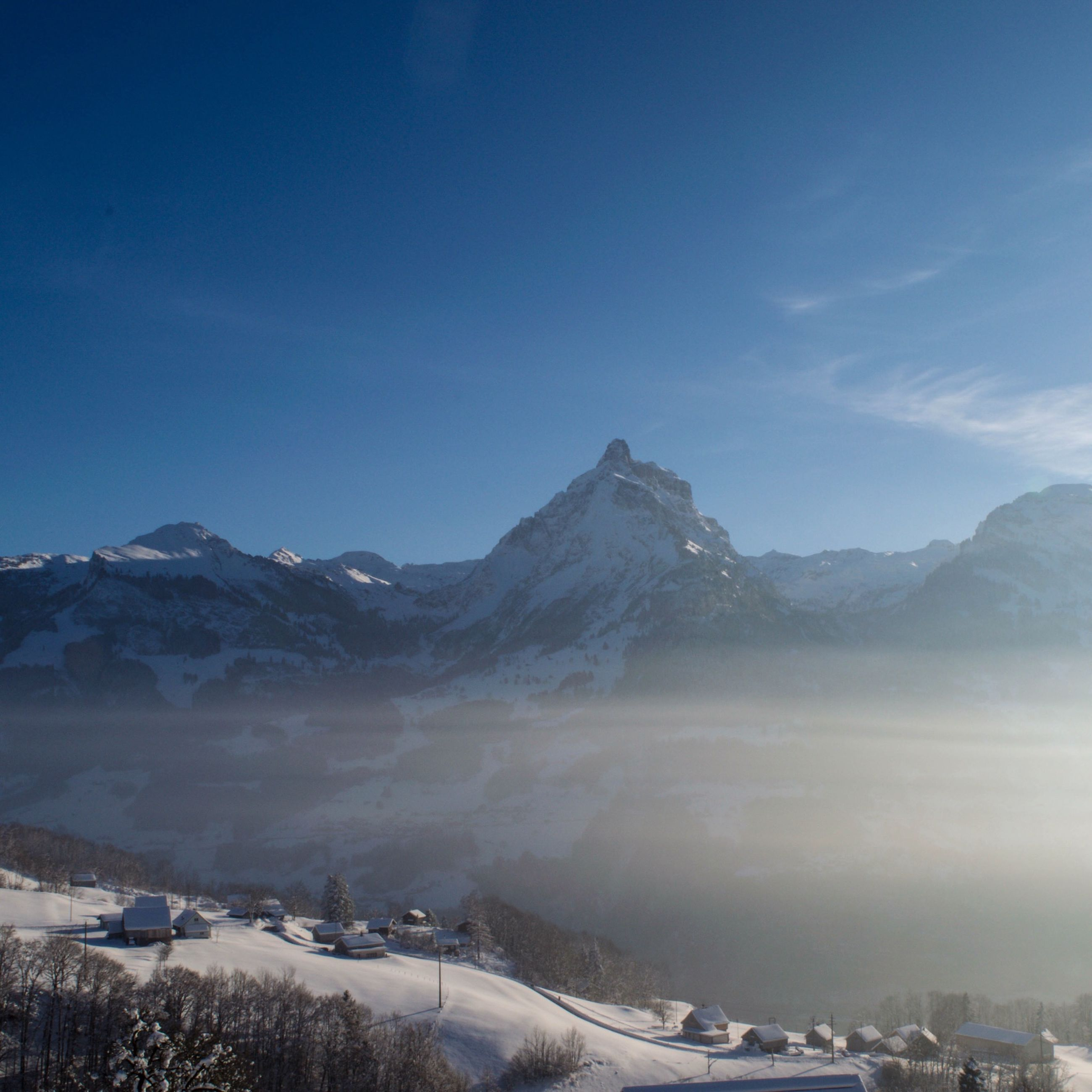 mountain, snow, winter, cold temperature, mountain range, snowcapped mountain, season, scenics, landscape, tranquil scene, beauty in nature, tranquility, nature, clear sky, weather, covering, sky, blue, building exterior, copy space