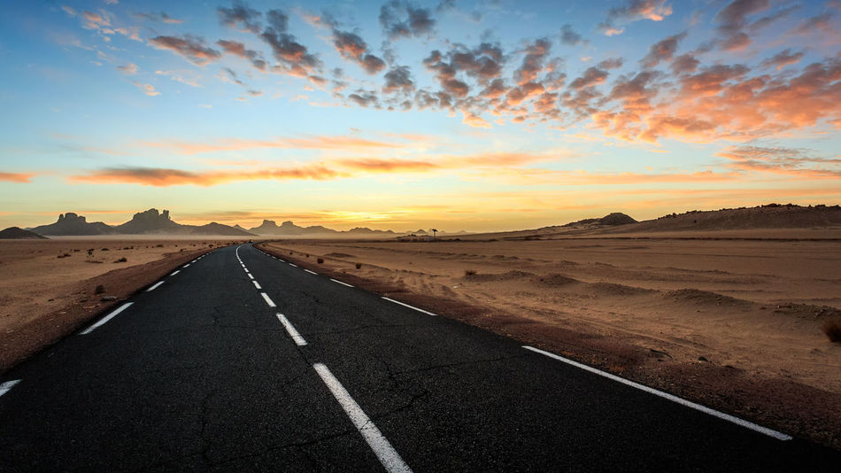 On The Road Beauty In Nature Day Desert Landscape Nature No People Outdoors Road Scenics Sky Sunset The Way Forward Tranquil Scene Tranquility Transportation