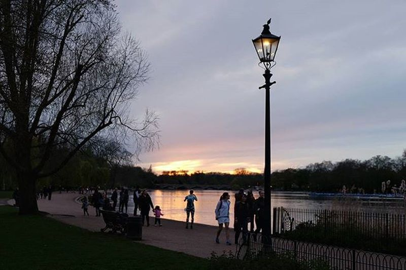 Snapping Sunset over the Serpentine A runner stops to take in the sunset at the Serpentine Lake, Hyde Park, London. Hydepark Royalparks Serpentine London Shutup_london London4all Runners Grittyprettylondon Sunset