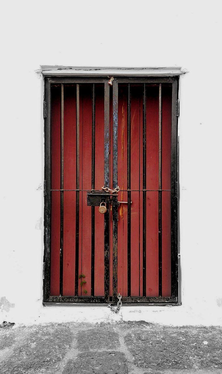 RED CLOSED DOOR OF BUILDING DURING WINTER
